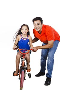 Father Teaching Daughter Ride Bicycle