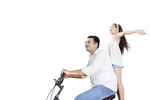 Father Daughter Riding Bicycle Together Cheering