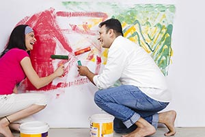Couple Painting Wall Home Improvement