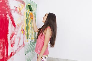 Home improvement: Little Girl Painting Wall Paint