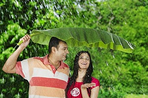 Indian Couple Enjoying Rain Park