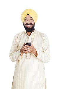 Punjabi Man Sending Message Phone Smiling