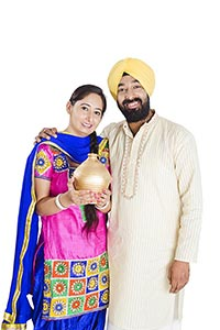 Punjabi Couple Saving Money Piggy bank