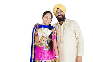 Portrait Indian Punjabi Couple Showing Money