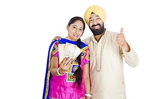 Sikh Couple Showing Money Thumbs up