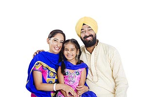 Indian Sikh Parents Daughter Sitting Smiling