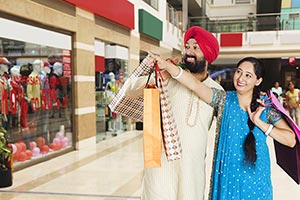 Punjabi Couple Shopping Bags Mall Pointing Looking