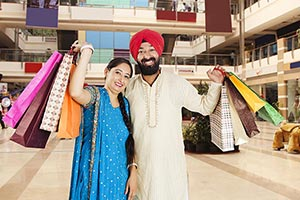 Sikh Couple Holding Shopping Bags Mall