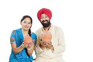 Sikh Couple Piggybanks Finance Saving Money