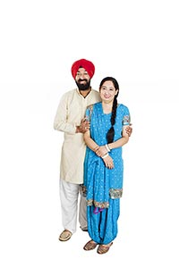 Sikh Couple Standing Together Smiling