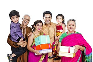 Indian Family Celebrating Diwali Festival Gifts