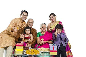 Indian Family Diwali Giving Sweets