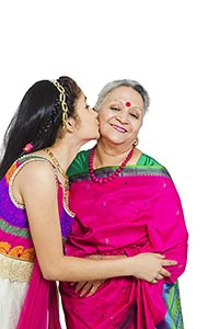 Indian Loving Granddaughter kissing Grandmother