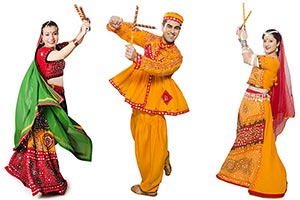 Men Women Performing Dandiya Navratri Celebrations