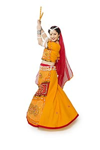Woman Lehenga Choli Performing Dandiya Dance