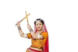Portrait Gujarati Woman Playing Dandia Smiling