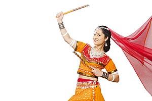 Indian Female Gujarati Performing Dandiya