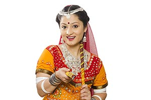 Traditional Gujarati Women Giving Dandiya Sticks