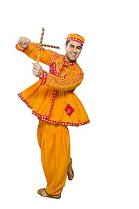 Indian Man Performing Dandiya Raas Navratri