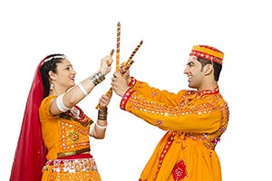 Couple Dancing Navratri Dandia Garba Festival