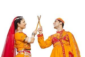 Gujarati Couple Dancer Performing Dandiya Dance