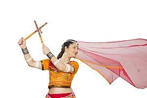Gujarati Woman Dancer Performing Dandiya Dance