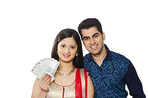 Happy Indian Couple Showing Money