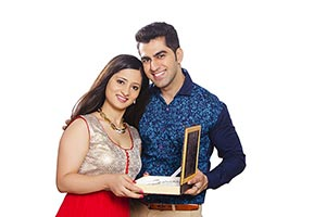 Happy Married Couple Receiving Gift Anniversary