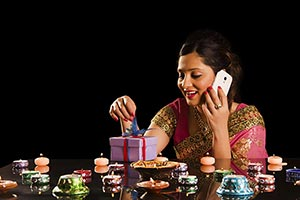 Woman Opening Gift Box Talking Phone Diwali