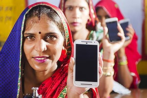 Rural Womans Workars Tailor Showing Smartphone