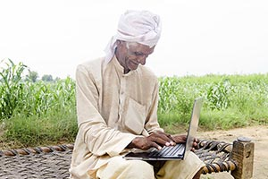 Old Man Farmer Educated Laptop working
