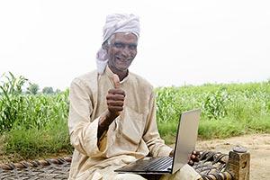 Rural Farmer Laptop Thumbsup