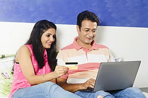 Indian Couple Online Shopping Laptop Credit card