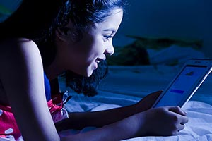 Little Girl Reading Message Digital tablet
