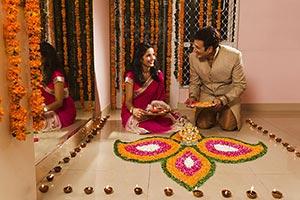 Couple Decorating Rangoli Oil Lamps Diwali