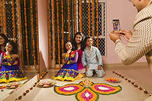 Family Celebrating Diwali Clicking Photo Smartphon