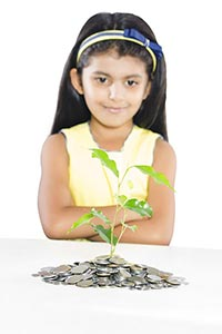 Little Girl Plant Growing Pile Coins