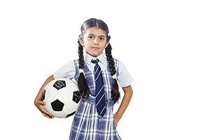 School Little Girl Holding Football