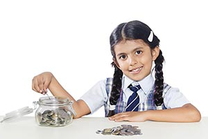 School Girl Putting Coin Saving Money Jar