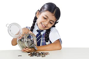 School Child Girl Counting Money Jar