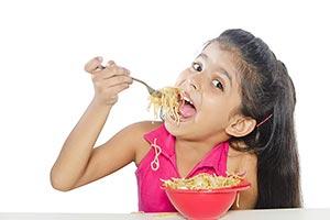 Little Girl Eating Noodle