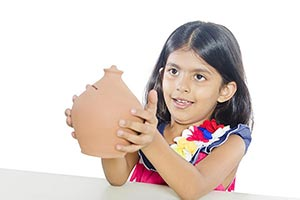 Little Girl Saving Money Piggy bank