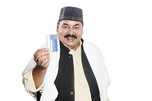 Muslim Senior Man Showing Credit Card