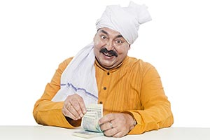 Indian Rural Farmer Counting Money Saving