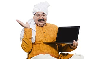 Educated Farmer Man Showing Laptop