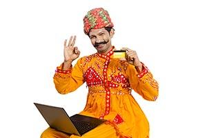 Gujrati Man Laptop Showing Credit card