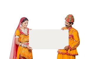 Gujrati Couple Holding Whiteboard Watching