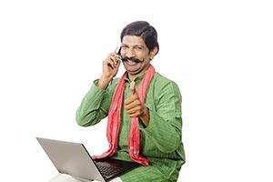 Rural Man Laptop Talking Phone