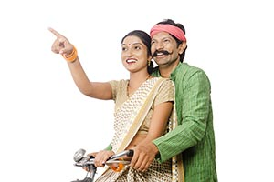 Rural Couple Riding Bicycle Pointing