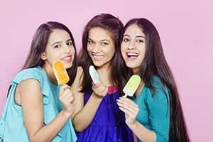 Teenage Girls Eating Ice cream